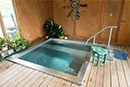 -- customized, stainless steel hydrotherapy relaxation system (hot tub) in sunroom