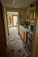 -- private 2-bed guest suite w/bathroom, kitchenette, forest balcony & separate entrance